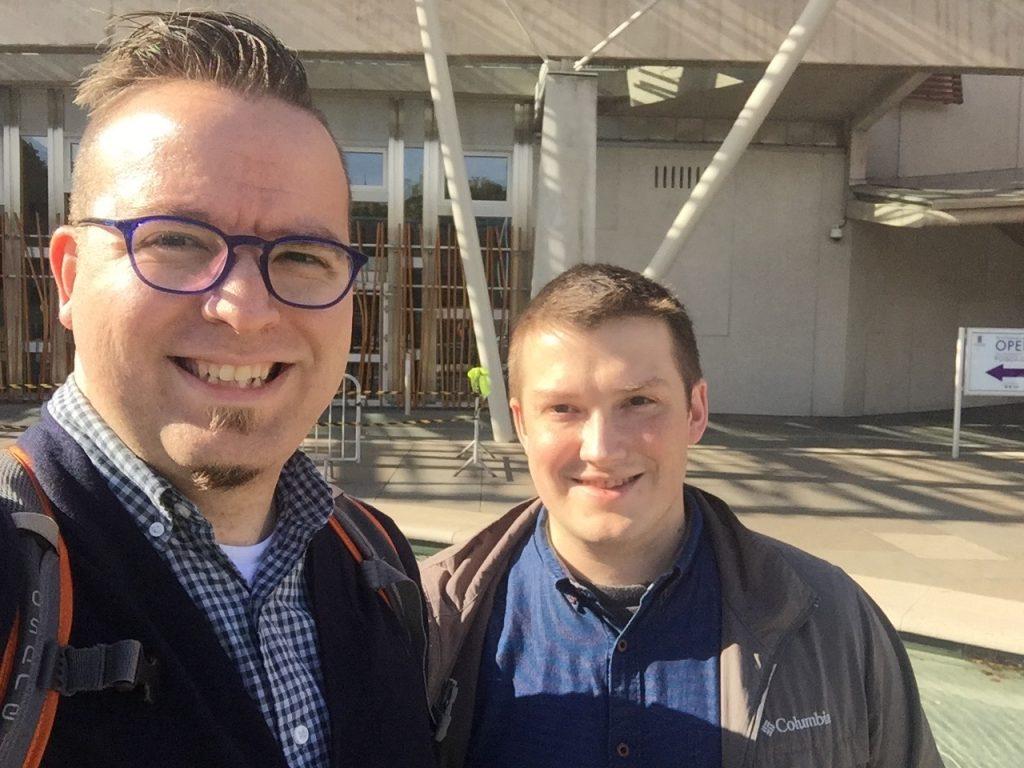 Matt and Adam outside Scottish Parliament
